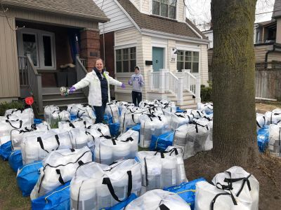 Nice lady with tons of packages on her front lawn
